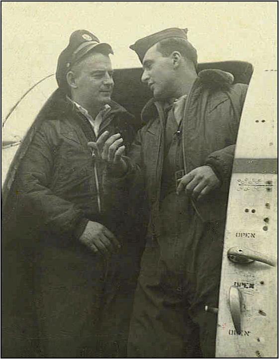 Emerson talking with pilot in the door of a C-47.