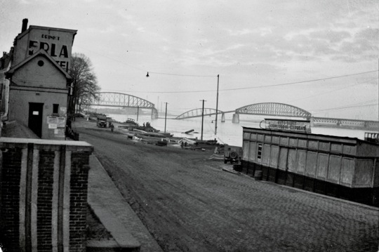 View of the Nijmegan, Holland railroad bridge in early November 1944. German frogmen were successfull in dropping the center span. The same section of span was damaged (and replaced later) during the German invasion of Holland in May of 1940.